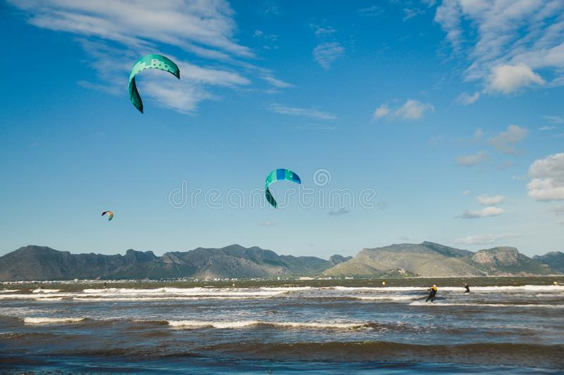 Mallorca, Spain - November 12, 2018: Kiteboarding. Mallorca, Spain - October 12, 2018: Kiteboarding. Entertainment in sea waves, Extreme sports Kitesurfing stock photography
