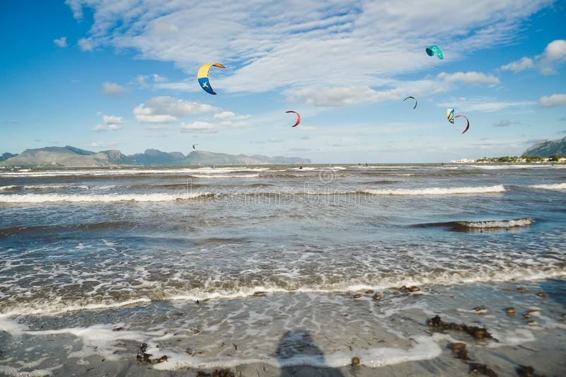 Mallorca, Spain - November 12, 2018: Kiteboarding. Mallorca, Spain - October 12, 2018: Kiteboarding. Entertainment in sea waves, Extreme sports Kitesurfing royalty free stock images