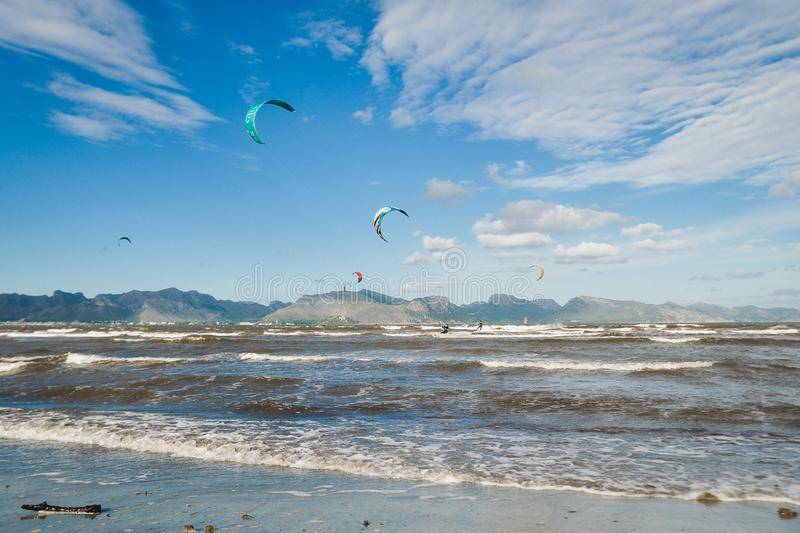 Mallorca, Spain - November 12, 2018: Kiteboarding. Mallorca, Spain - October 12, 2018: Kiteboarding. Entertainment in sea waves, Extreme sports Kitesurfing royalty free stock photography