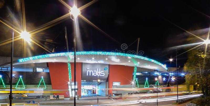 The Malls at Christmas. Basingstoke, United Kingdom - November 21 2017:   Night Photo of the entrance to the Malls Shopping centre with christmas decorations up stock image