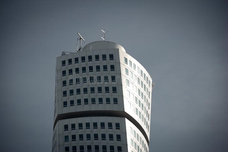 Malmö, Sweden - September 22, 2019: The top of the skyscraper Turning Torso, designed by architect Santiago Calatrava, seen on a. Bright summer day royalty free stock images