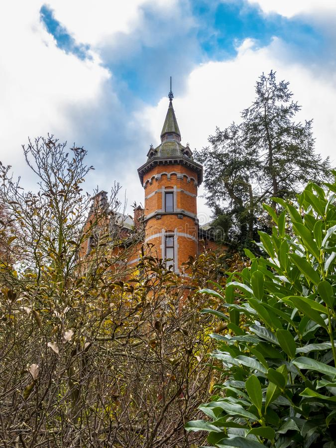 Malmedy, Belgium beautiful old architecture. November view of the tower of Villa Steisel in Malmedy, Belgium built in 1897, architectural detail royalty free stock photo