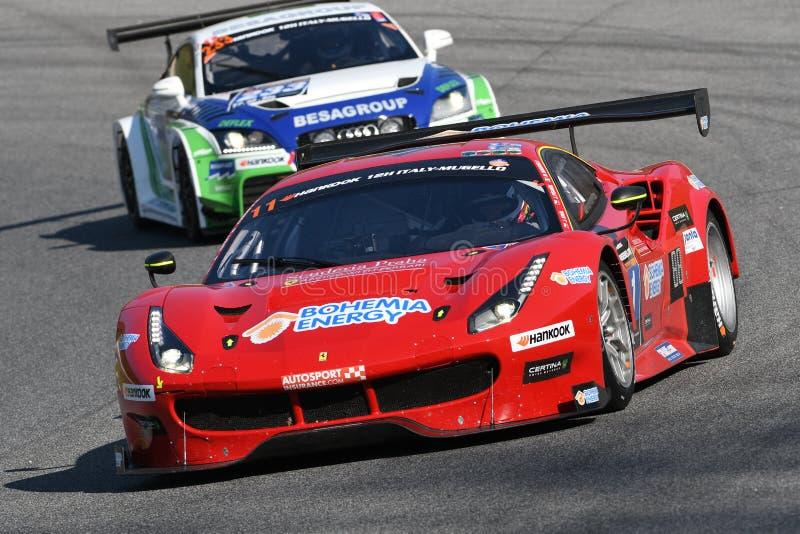 12 malmHankook Mugello 18 mars 2017: #11 Scuderia Praha, Ferrari 488 GT3: Jiri Pisarik Josef Krà¡ l, Matteo Malucelli på Mugel royaltyfri foto