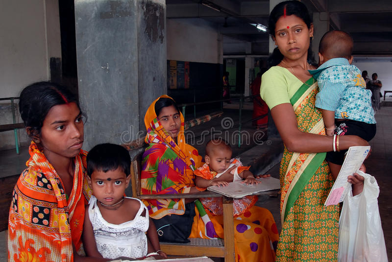 Malnourished Children in India. May 03, 2011-ThakurPukur,Kolkata, West Bengal,India -Poor mother & child in the clinic center of Kolkata. Half of India's royalty free stock photo