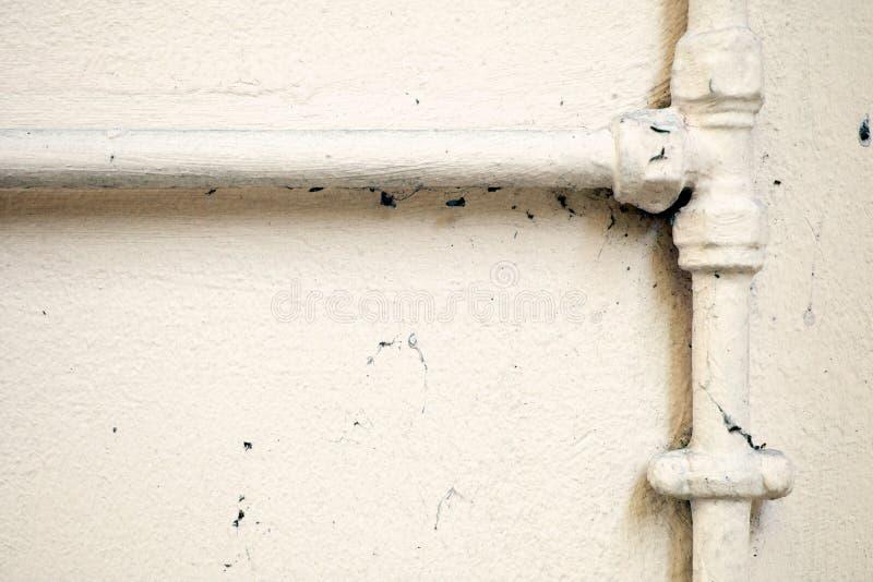 Malować instalacj wodnokanalizacyjnych drymby Na ścianie obrazy royalty free