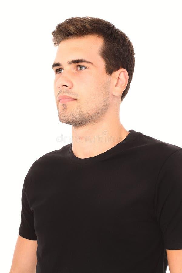 Malplaatje leeg zwart overhemd Portret van de slimme denkende jonge mens in zwart die overhemd op wit wordt geïsoleerd Spot omhoo stock foto's