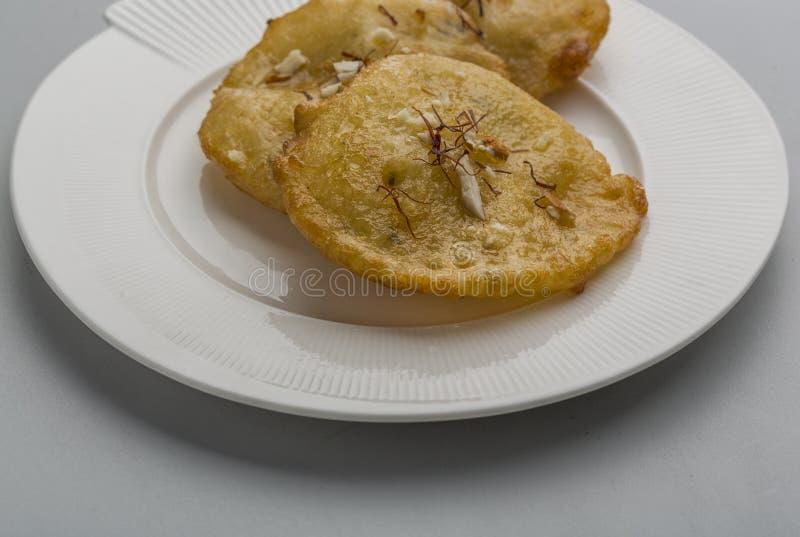 Malpua ett indiskt sött mellanmål royaltyfri foto