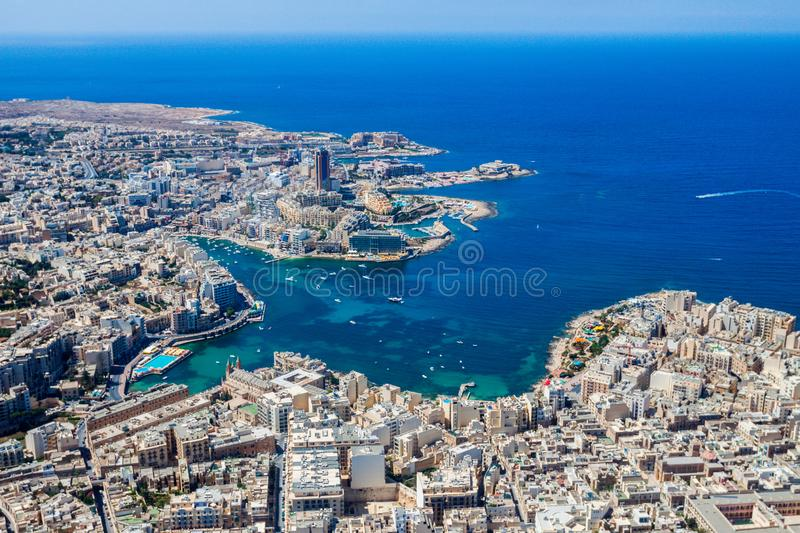 Malta aerial view. St. Julian`s San Giljan and Sliema cities. Towns and coastline of Malta from above. Skyscraper in Paceville. royalty free stock photo