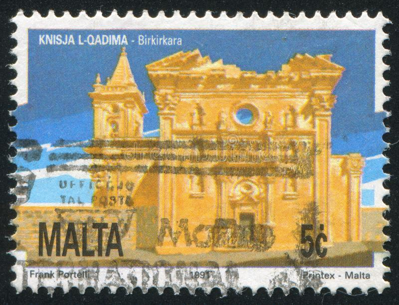 Old Church Birkirkara. MALTA - CIRCA 1991: stamp printed by Malta, shows Old Church Birkirkara, circa 1991 royalty free stock image