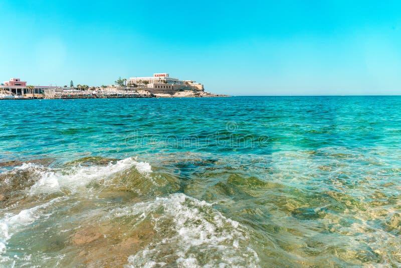 Malta Dragonara Casino from Sea blue sky clear water stock photos
