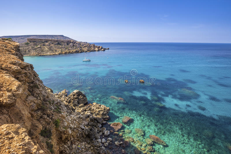 Malta - Ghajn Tuffieha bay view on a nice summer day with crystal clear water stock photo