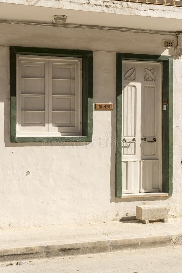 Doorway and window on a street near Gillieru Harbour Malta. Malta is an archipelago in the central Mediterranean between Sicily and the North African coast. It royalty free stock photos