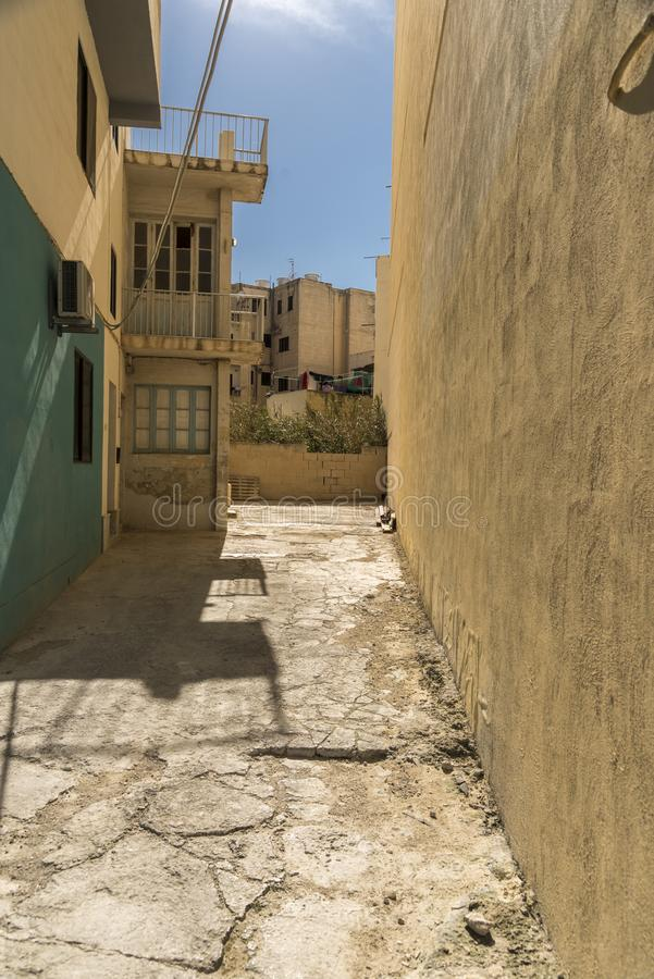 Steep side street St Pauls Bay Malta. Malta is an archipelago in the central Mediterranean between Sicily and the North African coast. It`s a nation known for royalty free stock photos