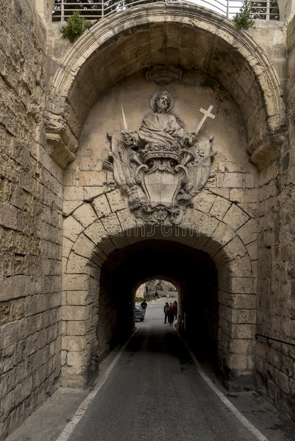 Tunnel entrance to the Greeks Gate Mdina Malta. Mdina, also known by its titles Città Vecchia or Città Notabile, is a fortified city in the Northern royalty free stock images