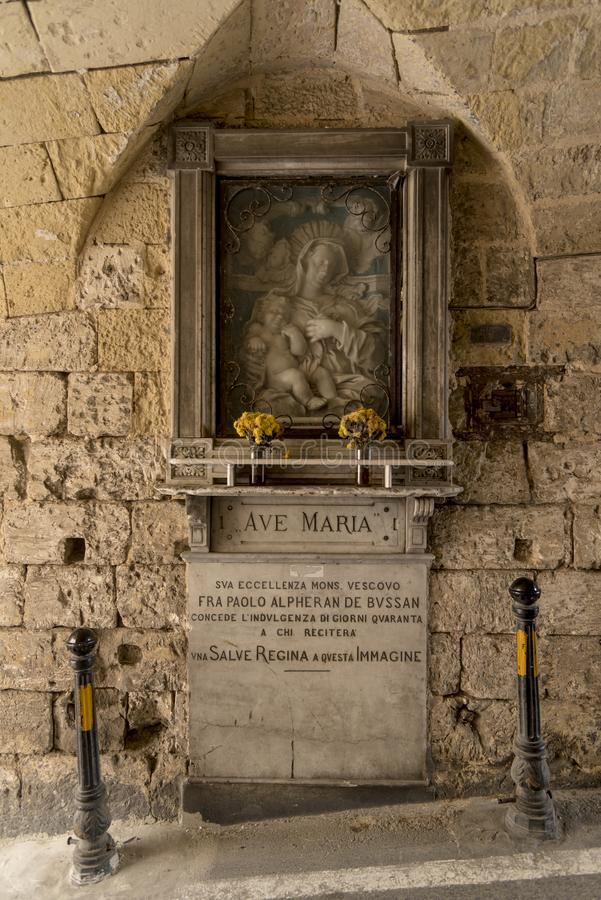 Prayer altar in the tunnel entrance to the Greeks Gate Mdina Malt. A. Mdina, also known by its titles Città Vecchia or Città Notabile, is a fortified city royalty free stock photos