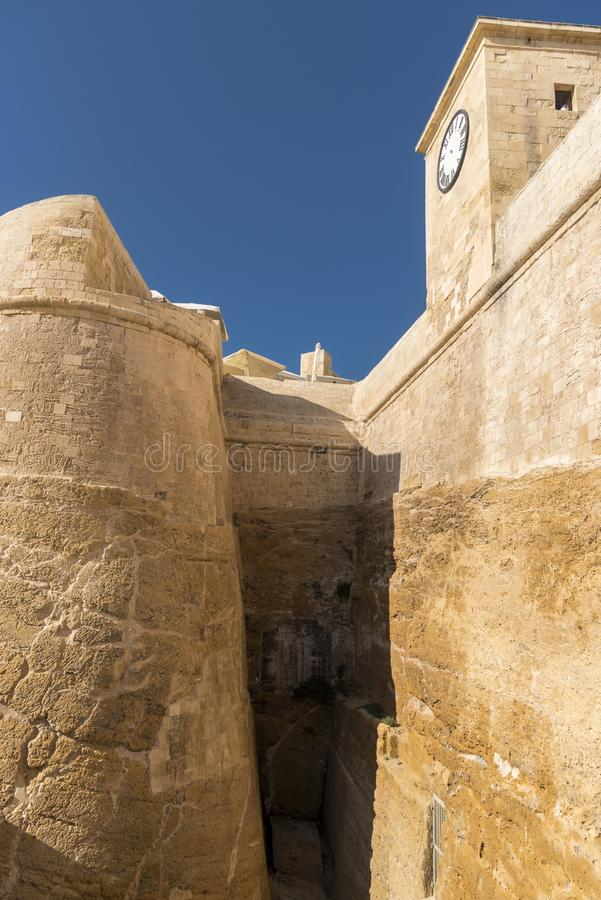 The walls and clock of the Citadel Victoria Gozo. Victoria also known as Rabat is the capital of Gozo Island, in Malta. It's known for its medieval royalty free stock images