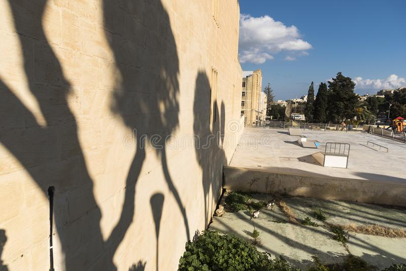 Shadowed wall and playground Victoria Gozo. Victoria also known as Rabat is the capital of Gozo Island, in Malta. It's known for its medieval Citadel stock image