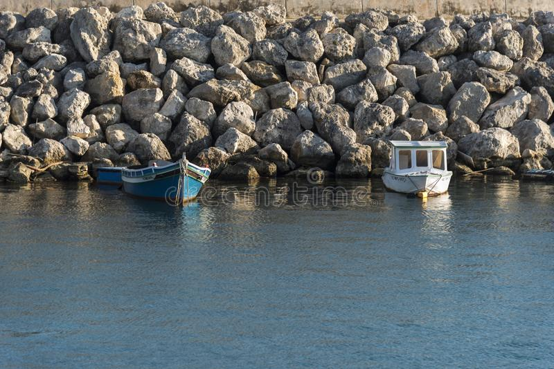 Small boats in Mġarr harbour Gozo, Malta. NMġarr is a harbour town in south-eastern Gozo, Malta. It's known for its medieval Citadel, with fortified royalty free stock photo