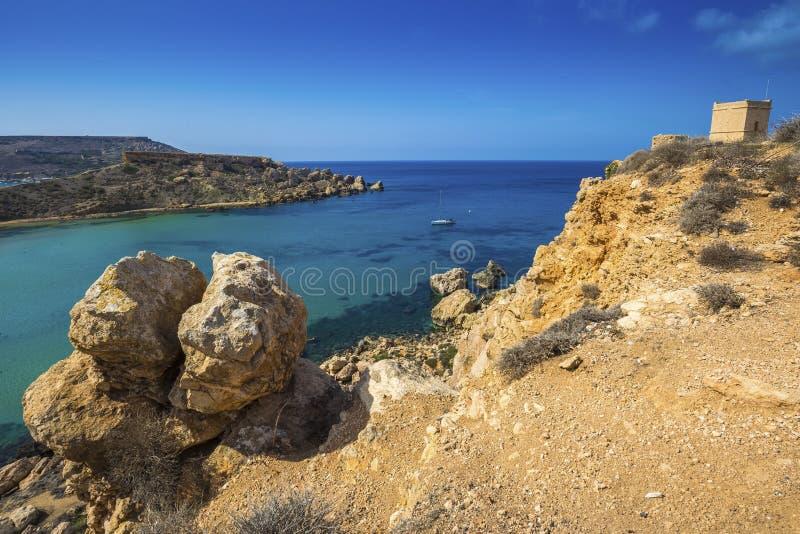 Malta - Huge rocks and Ghajn Tuffieha tower on a hot summer day stock photography