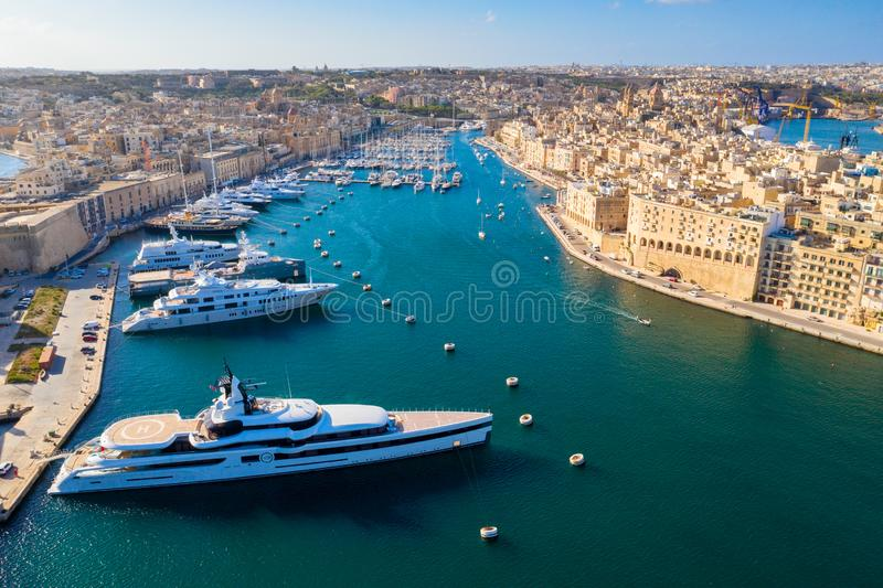 Malta island. Birgu and Senglea waterfront from above. Luxury yachts in city bay. Malta skyline stock image