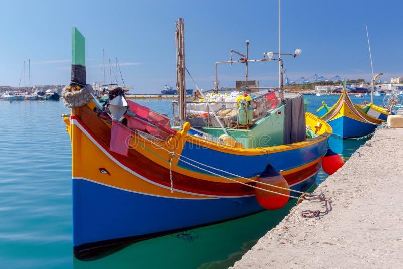 Malta. Marsaxlokk. Traditional fishing boats. Traditional multicolored fishing boats Luzzi in the harbor Marsaxlokk. Malta stock photos
