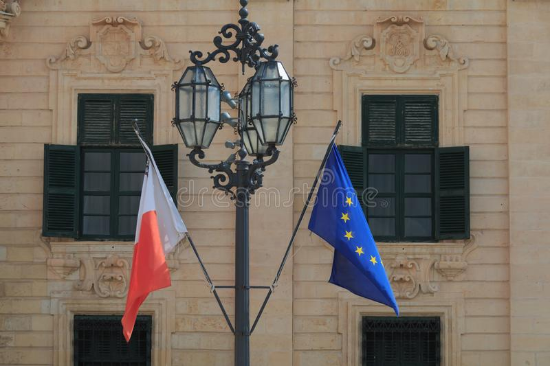 Malta national flag Europe union flag hang in front of old historic building in Valletta Malta stock images