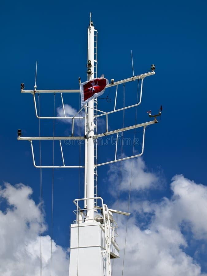 Malta Registered Seafaring Vessel. Maltese Cross flag on a Malta registered seafaring vessel stock images
