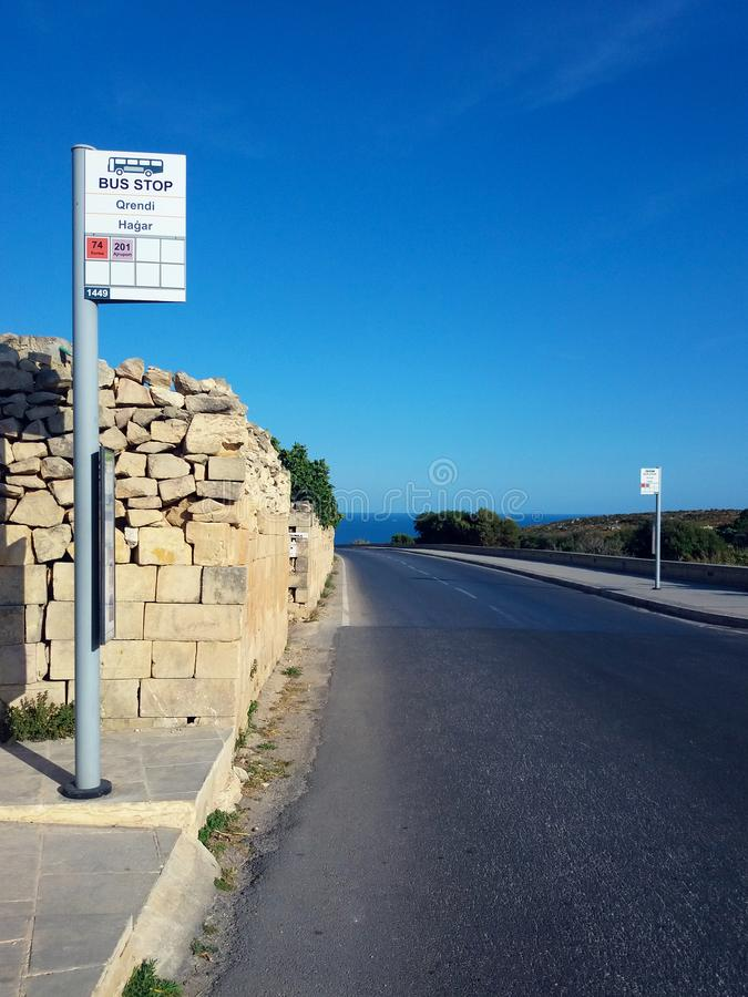 Malta road bus stop. Malta road and bus stop pole with blue sky and sunny day stock images