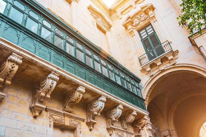 Malta`s long large green traditional style balconies and arch in the building royalty free stock images