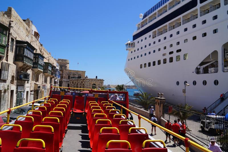 Malta. Valletta, July 2014. View of the mooring cruise ship from the deck of the hop-on-hop bus royalty free stock images