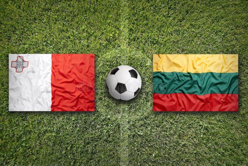 Malta versus De vlaggen van Litouwen op voetbalgebied royalty-vrije stock foto's