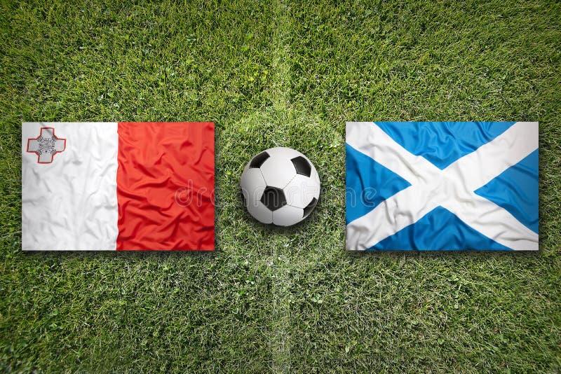 Malta versus De vlaggen van Schotland op voetbalgebied royalty-vrije stock afbeelding