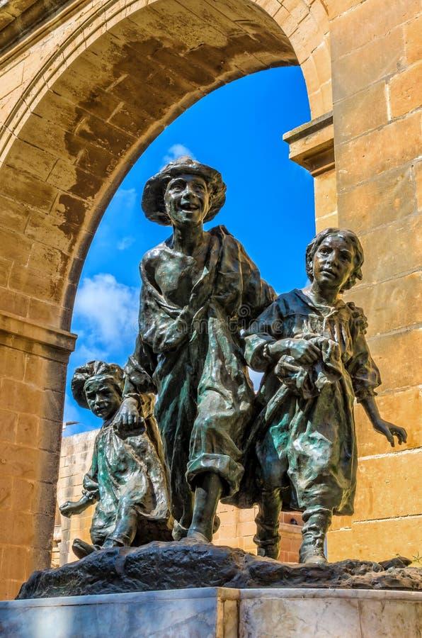 Malta, Views of Valletta. Les Gavroches, the bronze work of the Maltese sculptor, Antonio Sciortino in the Upper Barracca Gardens, the best known of the public royalty free stock photo