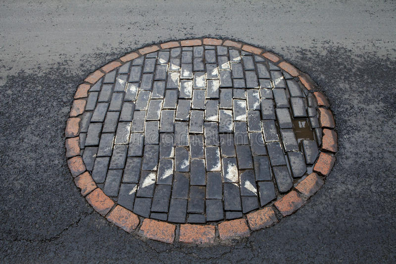 The Maltese Cross in Edinburgh. The Maltese Cross painted on the ground on Canongate along the Royal Mile in Edinburgh, Scotland royalty free stock photo