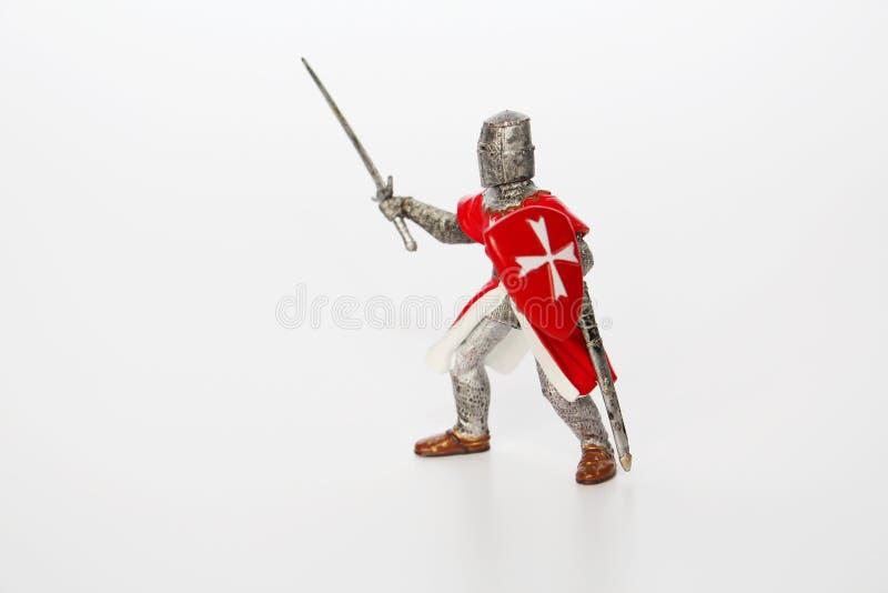 Maltesischer Ritter auf einem wei?en Hintergrund Spielzeug f?r Kinder stockbilder