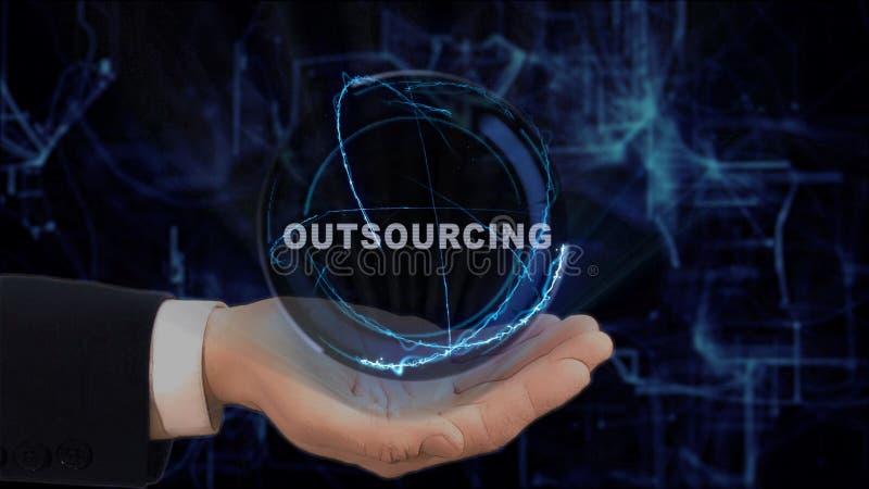 Malująca ręka pokazuje pojęcie holograma outsourcing na jego ręce obraz royalty free