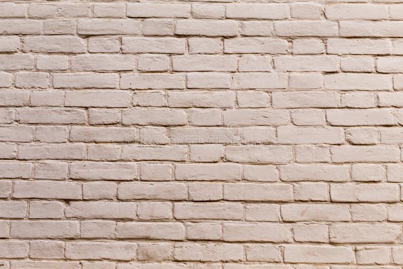 Malujący biały ściana z cegieł zdjęcia royalty free