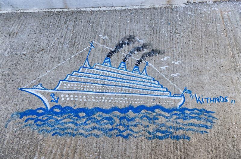 Malujący na ulicie w Kythnos wyspie, Cyclades, Grecja zdjęcia stock