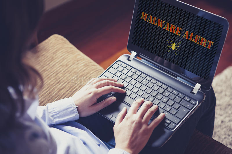 Malware alert in a laptop computer. royalty free stock image