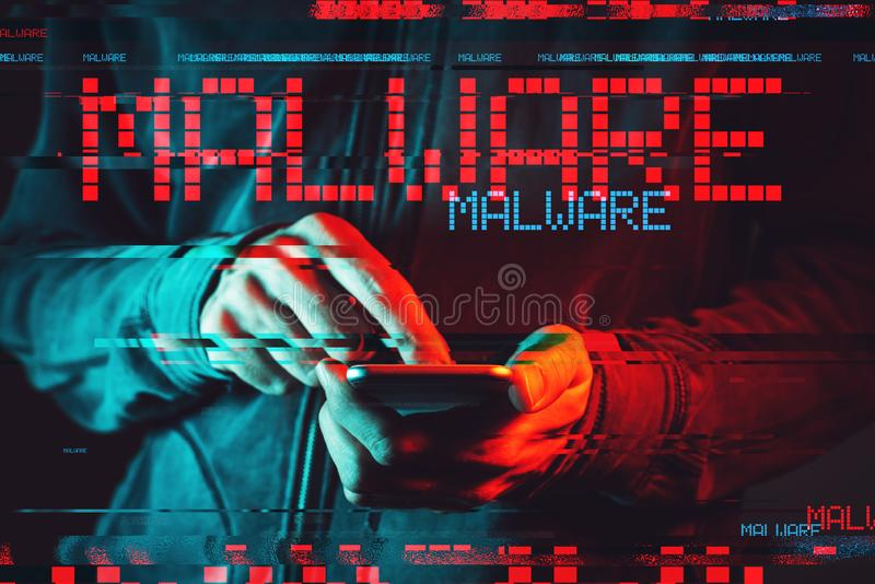 Malware concept with person using smartphone stock photography