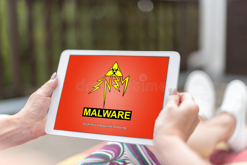 Malware concept on a tablet royalty free stock image