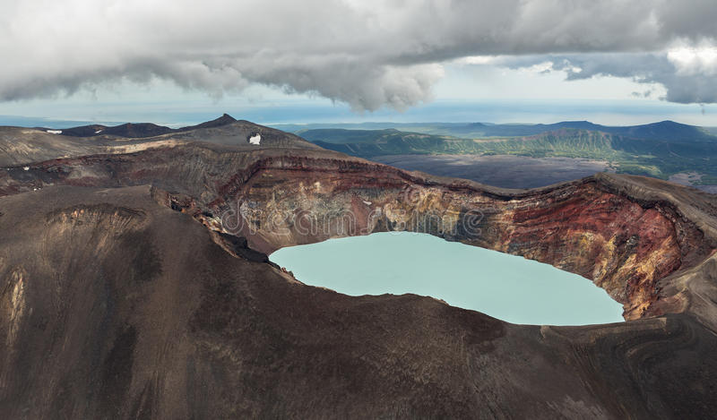 Maly Semyachik is a stratovolcano with acidic crater lake. Kronotsky Nature Reserve on Kamchatka Peninsula. View from helicopter royalty free stock photo