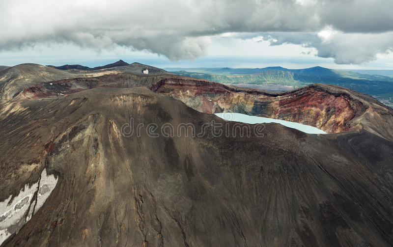 Maly Semyachik is a stratovolcano with acidic crater lake. Kronotsky Nature Reserve on Kamchatka Peninsula. View from helicopter royalty free stock photography