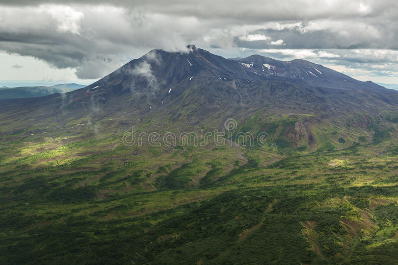 Maly Semyachik is a stratovolcano. Kronotsky Nature Reserve on Kamchatka Peninsula. View from helicopter stock images
