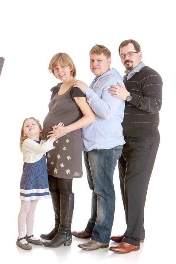 Mamã da família de quatro pessoas grávida imagem de stock royalty free