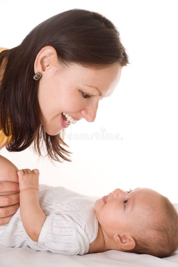 Mama chwyty stojaki i dziecko obrazy royalty free