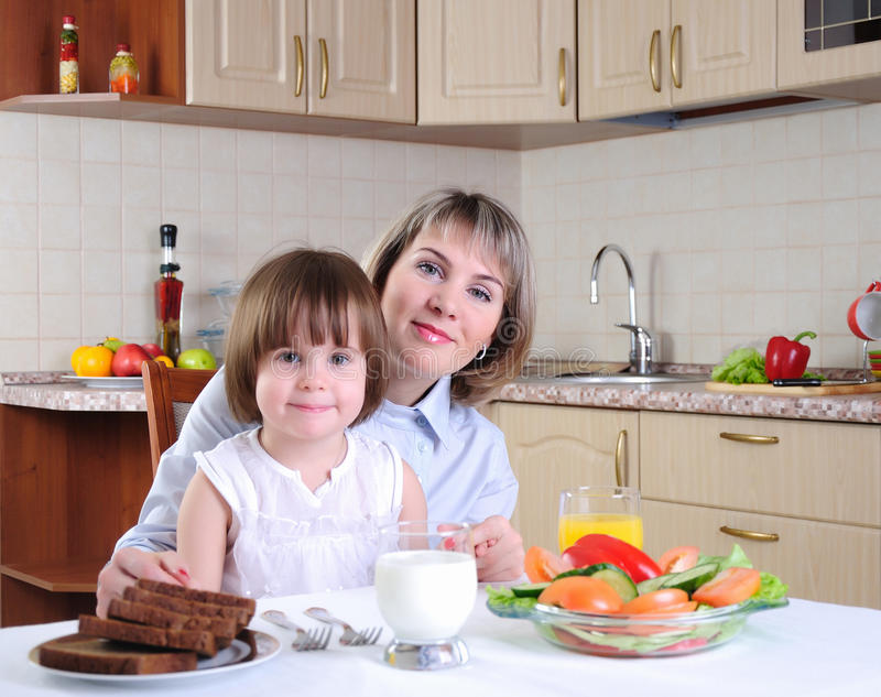 Mama and her little daughter royalty free stock photography