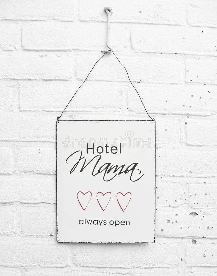 Mama Hotel always open - white square metal plate with text stock photo