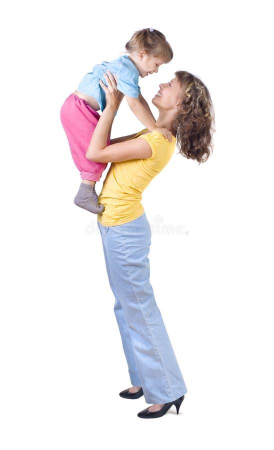 Mama que juega con el bebé fotografía de archivo