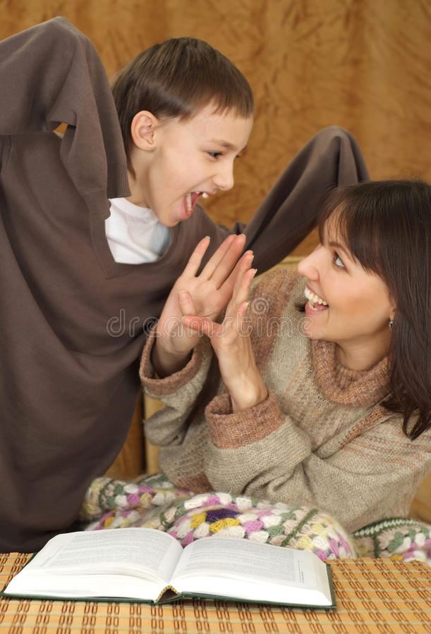 Download Mama and son fool around stock image. Image of young - 24496883